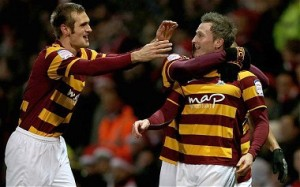 The Bradford City players celebrate knocking Arsenal out of the cup last night