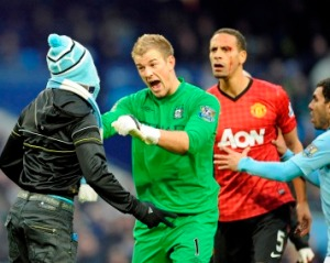 Joe Hart holds back a City fan from attacking Ferdinand