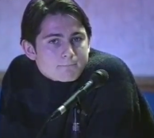 A young Frank listens to Harry Redknapp defending him at the AGM in 1996