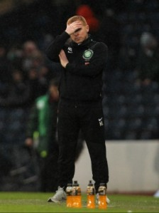 Disappointment for Neil Lennon as he watches Celtic crash out of the cup (Image from Thescore.ie)