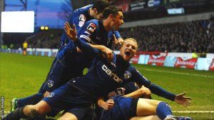 Oldham players celebrate their famous victory (Image from Getty)