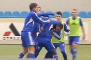 The two players are seperated by their teammates (Image from Youtube)
