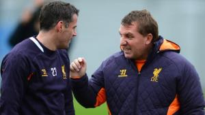 Carragher and Rodgers talk during a training session (Image from PA)