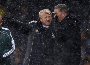 Back to the drawing board for Strachan and assistant McGhee (Image from Reuters/David Moir )