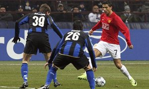 Ronaldo is double teamed against Inter (Image from PA)