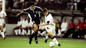 Owen outmuscles Ayala on route to goal at France 1998 (Image from Getty)