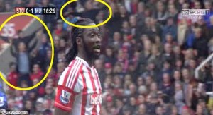 Stoke fans taunt the United fans with airplane gestures  (Image from Sky Sports)