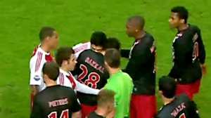 Luis Suárez bites Otman Bakka when playing for Ajax in 2011  (Image from Reuters)