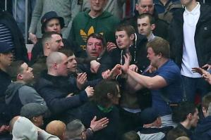 Millwall fans fight themselves at Wembley  (Image from The Sun)