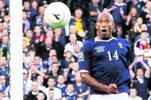 Chris Iwelumo misses on his debut for Scotland (Image from Reuters)