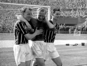 Trautmann is helped from the pitch by his teammates  (Image from Getty)