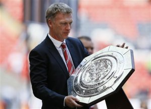 In the Bag - Moyes with Trophy No.1 (Image from Getty)