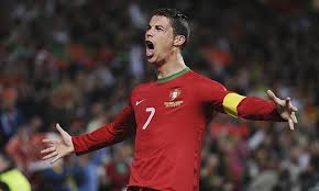 Ronaldo celebrates securing Portugals passage to Brazil (Image from PA)