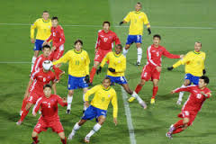All hands on Deck - North Korea defend in numbers against Brazil  (Image from FIFA)