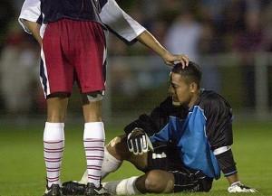 Nicky Salapu slumped on the pitch during Australia's 31-0 trashing of American Samoa (Image from PA)