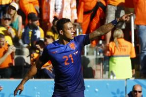 Memphis Depay set up and score a goal in Holland's 3-2 win over Australia (Image from Getty)