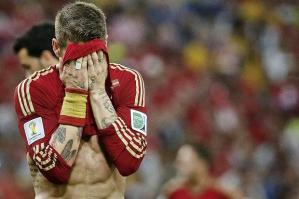 Sergio Ramos cna barely watch as Spain crash out (Image from Getty)