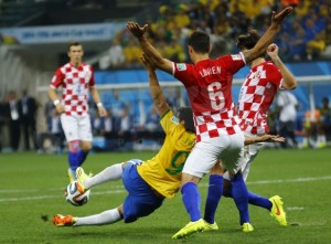 Fred falls in the box under the challenge of Lovren  (Image from PA)