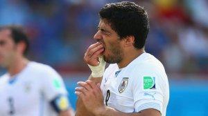 Hero to Villan - Suarez bites again (Image from Getty)