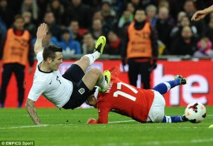 Chile are a tough tackling side as England found out recently (Image from PA)