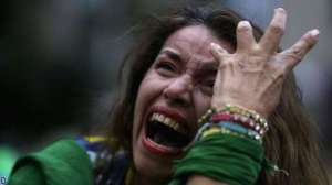 Brazil fans couldn't believe what they were seeing (Image from AFP)