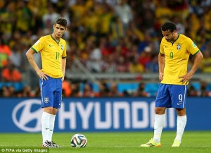 Blitz complete - A shell-shocked Brazil survey the damage (Image from FIFA via Getty)