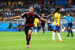 Klose scores his record breaking 16th goal  (image from Getty)