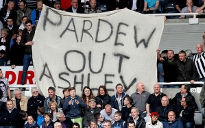 Pardew out banners displayed at recent matches by the fans  (Image from AFP)