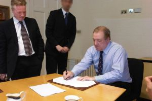 Defining moment - Former owner David Murray signs the club over to Craig Whyte  (Image from AFP)