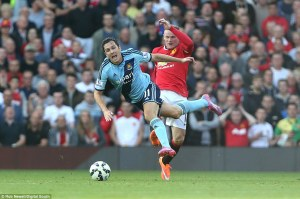 Rooney snaps kicking out at Downing  (Image from Rob Newall/Digital South)