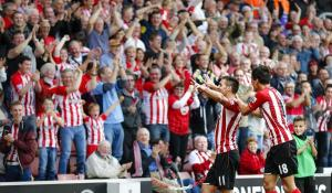 All Smiles - Southampton fans cheer as their side destroys Sunderland 8-0  (Image from AFP)