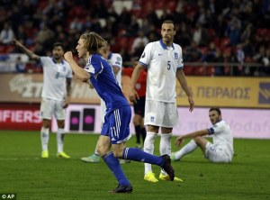 Joan Edmundsson celebrates his goal against Greece  (Image from AFP)