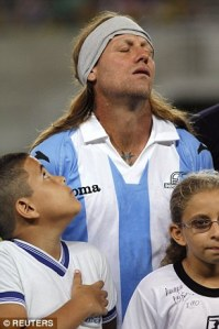Wait a second? Even the mascot didnt believe it was Caniggia as Cordone tries to pull a fast one (Image from Reuters)