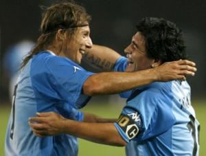 Caniggia and Maradona embrace during another veterans match in Georgia earlier this year  (Image from REUTERS/David Mdzinarishvili)