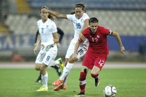 Christine Sinclair, right, of Canada challenges for the ball with Fara Williams of England during the Cyprus Cup final (Image from AP Photo/Petros Karadjias)