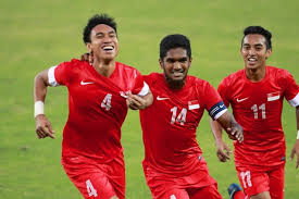 Singapore celebrate scoring at the 2013 SEA Games  (Image from AFP)