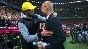 Klopp and Guardiola embrace after Dortmund ruin Bayern's treble chance (Image from Getty)