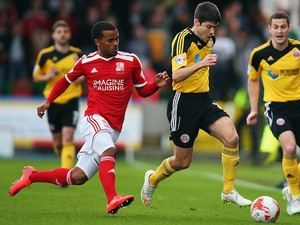 The superb Nathan Byrne battles with Ryan Flynn for the ball  (Image from AP)