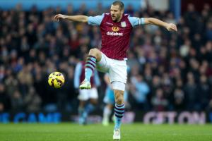 Ron Vlaar is one of 154 players released by their Premiership clubs  (Image from AFP)