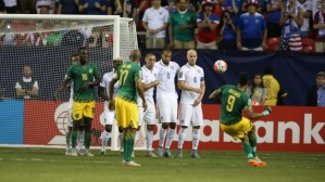 Giles Barnes curls his free kick round the wall to give Jamaica a 2-0 lead  (Image from PA)