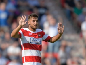 Harry Forrester holds his hands up after scoring a bizarre goal  (Image from PA)