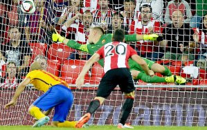 Aritz Aduriz scores his first of three against Barca in the first leg  (Image from PA)