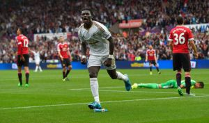 Gomis scores to seal all three points for Swansea (Image from PA)