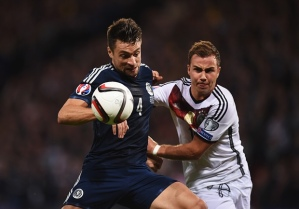 Scotland and Germany tussle for the ball (Image from Getty)