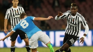 Paul Pogba battles for possession against Napoli (Image from Getty)