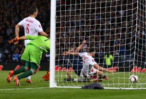 Poland's last minute equalizer knocked Scotland out of contention (Image from PA)