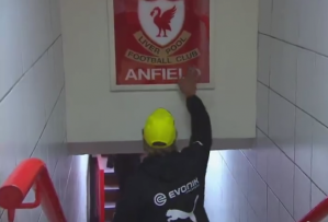 Klopp touches the Anfield sign last year (Image from Getty)