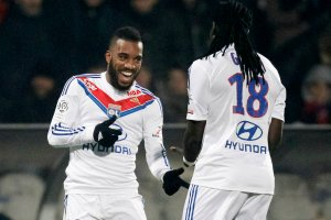 Alexandre Lacazette and Bafetimbi Gomis were transformed by Garde at Lyon (Image from AFP)