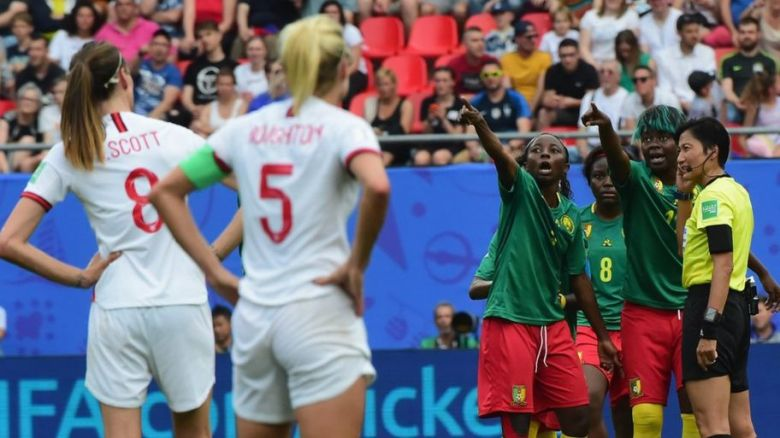 Cameroon players plead with the referee to look at the video board for a VAR call during the Womens World Cup (Image from Tumblr)